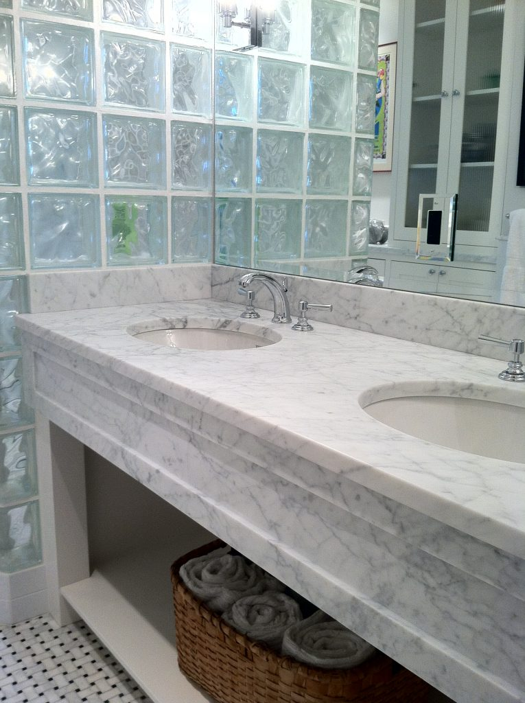 double sink bathroom countertop with front panel of stone