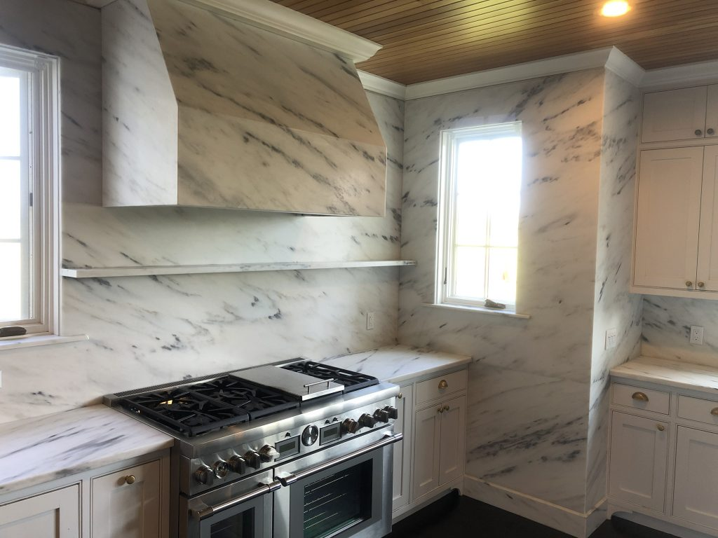large complete stone kitchen (floor to ceiling wall, countertop, exhaust hood, baseboards, and protruding shelfs)