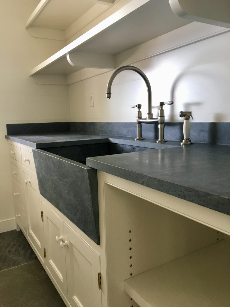 stone countertop with stone sink basin